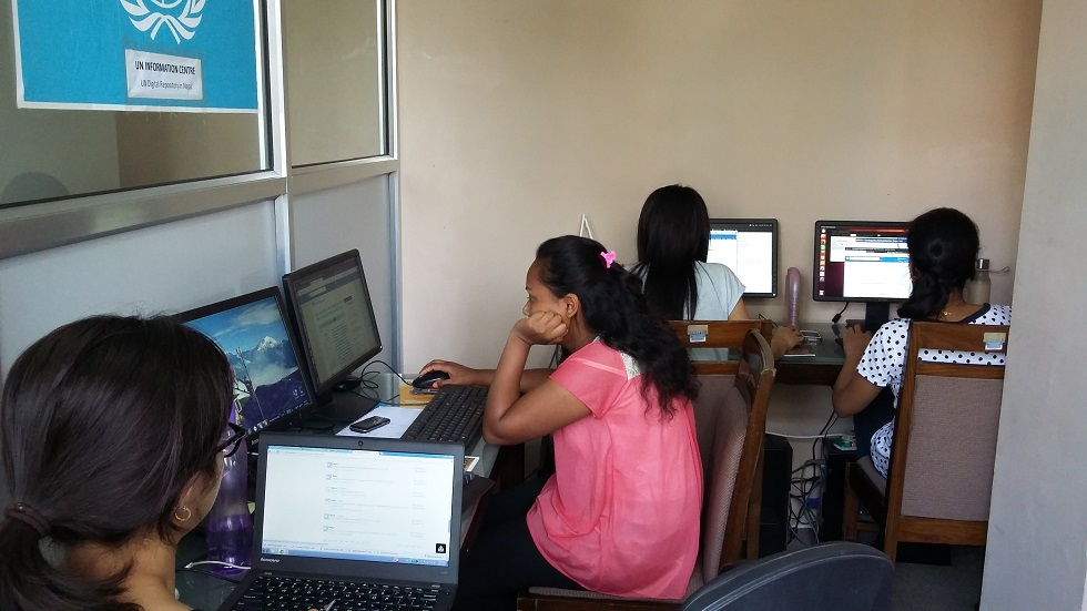 UN interns working in digital repository during emergency of earthquake to deliver information to public.